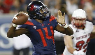 Arizona quarterback Khalil Tate (14) throws downfield against Southern Utah in the first half during an NCAA college football game, Saturday, Sept. 15, 2018, in Tucson, Ariz. (AP Photo/Rick Scuteri)