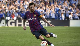 FC Barcelona's Lionel Messi controls the ball during the Spanish La Liga soccer match between Real Sociedad and FC Barcelona at the Anoeta stadium, in San Sebastian, northern Spain, Saturday, Sept. 15, 2018. (AP Photo/Jose Ignacio Unanue)