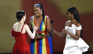 Tiffany Haddish, second left, and Angela Bassett, right, present the award for outstanding lead actress in a comedy series to Rachel Brosnahan at the 70th Primetime Emmy Awards on Monday, Sept. 17, 2018, at the Microsoft Theater in Los Angeles. (Photo by Chris Pizzello/Invision/AP)
