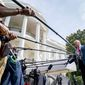 A former McCain campaign adviser says that voters are becoming weary of the slams against President Trump and losing their power. President Trump faces the press and their many microphones during a brief encounter on the White House lawn. (AP Photo/Andrew Harnick) (Associated Press)