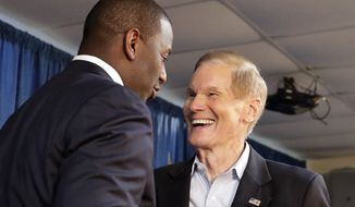 Florida Democratic gubernatorial candidate Andrew Gillum, left, greets Sen. Bill Nelson, D-Fla. before speaking to supporters at a Democratic Party rally Friday, Aug. 31, 2018, in Orlando, Fla. (AP Photo/John Raoux)