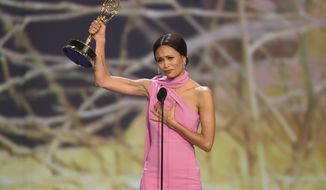 "Thandie Newton accepts the award for outstanding supporting actress in a drama series for ""Westworld"" at the 70th Primetime Emmy Awards on Monday, Sept. 17, 2018, at the Microsoft Theater in Los Angeles. (Photo by Phil McCarten/Invision for the Television Academy/AP Images)"