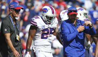 Buffalo Bills medical staff attends to running back LeSean McCoy (25) after being injured against the Los Angeles Chargers during the second half of an NFL game on Sunday, Sept. 16, 2018, in Orchard Park, N.Y. (AP Photo/Rich Barnes) ** FILE **
