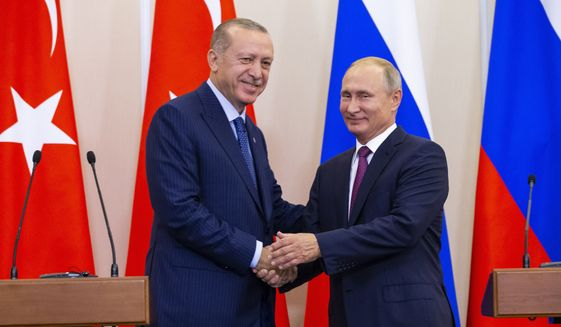 Russian President Vladimir Putin, right, and Turkish President Recep Tayyip Erdogan shake hands after their joint news conference following the talks in the Bocharov Ruchei residence in the Black Sea resort of Sochi in Sochi, Russia, Monday, Sept. 17, 2018. (AP Photo/Alexander Zemlianichenko, Pool) ** FILE **