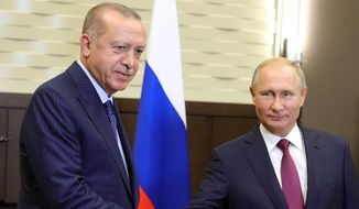 Russian President Vladimir Putin, right, and Turkish President Recep Tayyip Erdogan shake hands during their meeting at the Bocharov Ruchei residence, in Sochi, Russia, Monday, Sept. 17, 2018. The presidents of Russia and Turkey met in the Russian Black Sea resort of Sochi on Monday in a bid to find a diplomatic resolution to the crisis around a rebel-held region in Syria. (Mikhail Klimentyev, Sputnik, Kremlin Pool Photo via AP)