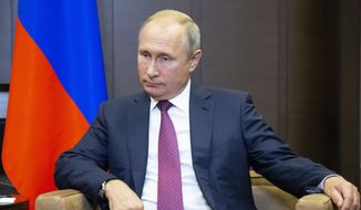 Russian President Vladimir Putin listens to Turkish President Recep Tayyip Erdogan during their meeting in the Bocharov Ruchei residence in the Black Sea resort of Sochi in Sochi, Russia, Monday, Sept. 17, 2018. The presidents of Russia and Turkey are meeting in the Russian Black Sea resort of Sochi on Monday in a bid to find a diplomatic resolution to the crisis around a rebel-held region in Syria. (AP Photo/Alexander Zemlianichenko, Pool)