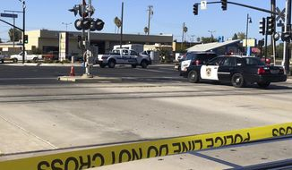 Police vehicles block streets some distance away from there two Sacramento County sheriff's deputies and a bystander were shot during an incident in Rancho Cordova, Calif., just outside Sacramento, Monday, Sept. 17, 2018. Department spokesman Sgt. Shaun Hampton says the suspect is in custody. Hampton says the shooting Monday afternoon occurred at a Pep Boys auto parts store, but did not provide details on the deputies' or the bystander's condition. (AP Photo/Jonathan J. Cooper)