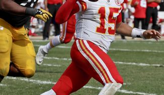Kansas City Chiefs quarterback Patrick Mahomes (15) scrambles away from Pittsburgh Steelers defensive end Stephon Tuitt (91) in the second half of an NFL football game, Sunday, Sept. 16, 2018, in Pittsburgh. The Kansas City Chiefs won 42-37. (AP Photo/Gene J. Puskar)