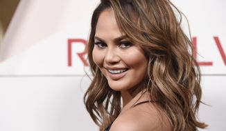 FILE - In this Nov. 2, 2017, file photo, model Chrissy Teigen poses at the 2017 Revolve Awards at the Dream Hollywood hotel in Los Angeles. Teigen said people have been mispronouncing her last name for years and she hasn't corrected them. But the model took to social media on Sunday, Sept. 16, 2018, to say it's not Teigen (TEE'-gihn), but Teigen (TY'-gihn). (Photo by Chris Pizzello/Invision/AP, File)