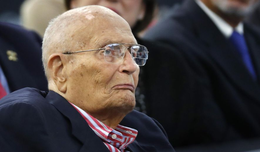 In this Oct. 19, 2016, file photo, former U.S. Rep. John Dingell, D-Mich., listens to Democratic vice presidential candidate Sen. Tim Kaine, D-Va. speak during a campaign stop in Detroit. (AP Photo/Paul Sancya, File)