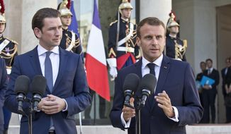 Austrian Chancellor Sebastian Kurz, left, and French President Emmanuel Macron make declarations prior to their meeting at the Elysee Palace in Paris, France, Monday, Sept. 17, 2018. Austrian Chancellor Sebastian Kurz is in Paris to discuss the informel European Summit in Salzburg next Thursday Sept. 20, 2018. (AP Photo/Michel Euler, Pool)