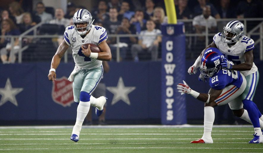 223811802 Dallas Cowboys quarterback Dak Prescott (4) scrambles for yards against the  New York Giants