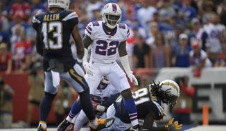 Buffalo Bills' Vontae Davis, center, gets up after Los Angeles Chargers' Mike Williams, right, scores a touchdown during the first half of an NFL football game, Sunday, Sept. 16, 2018, in Orchard Park, N.Y. How's THAT for a halftime adjustment? While the rest of the Buffalo Bills jogged into the locker room at halftime of their game against the Los Angeles Chargers, cornerback Vontae Davis jogged in, then just kept on going. Later, Davis posted on Twitter that he was, in fact, calling it a career.(AP Photo/Adrian Kraus) **FILE**