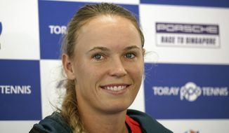 Caroline Wozniacki of Denmark smiles duirng a press conference prior to the Pan Pacific Open tennis tournament in Tokyo Monday, Sept. 17, 2018. (AP Photo/Eugene Hoshiko)