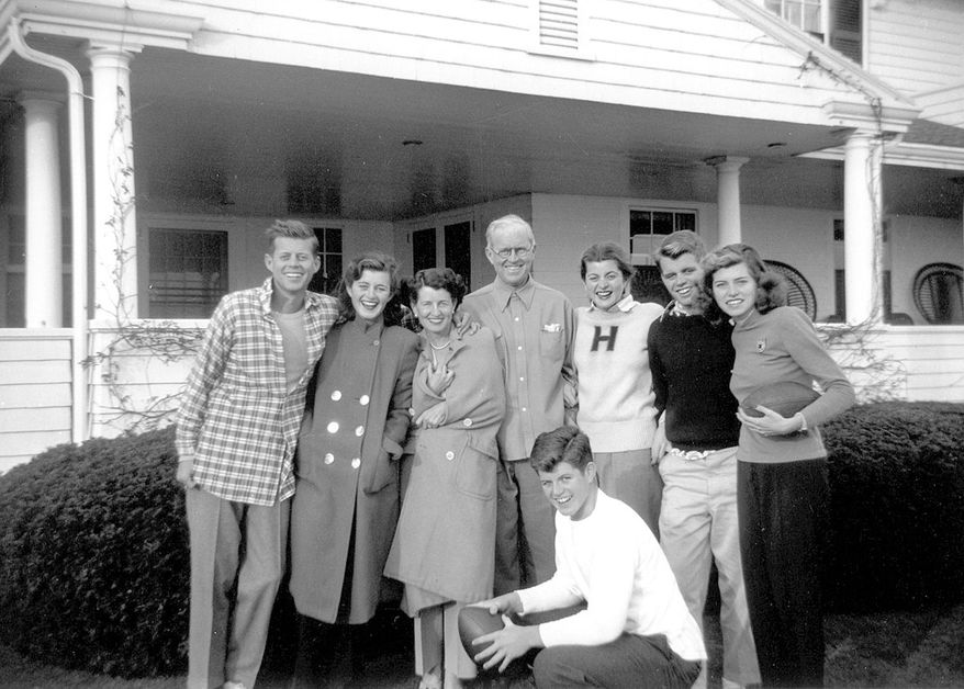 """In this circa 1948 photo provided by the Kennedy Family Collection, courtesy of the John F. Kennedy Library Foundation, members of the Kennedy family pose for a photo in Hyannis Port, Mass. They are from left, John F. Kennedy, Jean Kennedy, Rose Kennedy, Joseph P. Kennedy Sr., Patricia Kennedy, Robert F. Kennedy, Eunice Kennedy, and in foreground, Edward M. Kennedy. The Boston-based museum completed an 18-month project in 2018 to catalog and digitize more than 1,700 black-and-white Kennedy family snapshots that are viewable online, giving a nation still obsessed with """"Camelot"""" a candid new glimpse into their everyday lives. (Kennedy Family Collection/John F. Kennedy Library Foundation via AP)"""