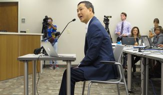 Dr. Victor Chou, who has opened a medical marijuana clinic in Baton Rouge, speaks to the Louisiana State Board of Medical Examiners, which was considering changes to a rule limiting how many medical marijuana patients a doctor can treat, on Monday, Sept. 17, 2018, in New Orleans. (AP Photo/Melinda Deslatte)