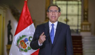 In this photo provided by the Peruvian government, Peru's President Martin Vizcarra speaks during a national message at the government palace in Lima, Peru, Sunday, Sept. 16, 2018. Vizcarra called to the Congress approve his proposals on Wednesday seeking to be submitted to a referendum in December to reform the political and judicial system, which if denied by Parliament could give way to the president closing the Congress. (Andres Valle/Andina News Agency via AP)