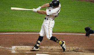 Pittsburgh Pirates' Adam Frazier drives in two runs with a double off Kansas City Royals starting pitcher Brad Keller in the fourth inning of a baseball game in Pittsburgh, Monday, Sept. 17, 2018. (AP Photo/Gene J. Puskar)