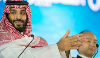 FILE - In this Tuesday, Oct. 24, 2017, file photo released by the state-run Saudi Press Agency, Saudi Crown Prince Mohammed bin Salman speaks at the opening ceremony of Future Investment Initiative Conference in Riyadh, Saudi Arabia. Saudi Arabia's sovereign wealth fund invested over $1 billion on Monday, Sept. 17, 2018, in an American electric car manufacturer just weeks after Tesla CEO Elon Musk earlier claimed the kingdom would help his own firm go private. (Saudi Press Agency via AP, File)