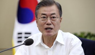 South Korean President Moon Jae-in speaks during a cabinet meeting at the presidential Blue House in Seoul, South Korea, Monday, Sept. 17, 2018. A senior South Korean official on Monday played down the chance that this week's inter-Korean summit will result in major progress in efforts to rid North Korea of its nuclear program. (Hwang Gwang-mo/Yonhap via AP)