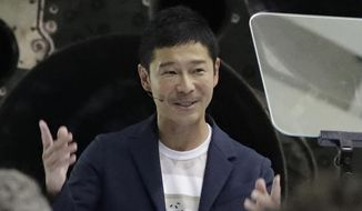 Japanese billionaire Yusaku Maezawa speaks after SpaceX founder and chief executive Elon Musk announced him as the person who would be the first private passenger on a trip around the moon, Monday, Sept. 17, 2018, in Hawthorne, Calif. (AP Photo/Chris Carlson)