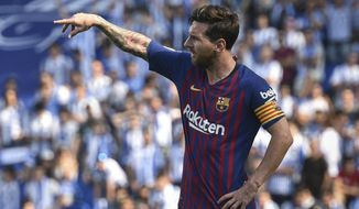 FC Barcelona's Lionel Messi gestures during the Spanish La Liga soccer match between Real Sociedad and FC Barcelona at the Anoeta stadium, in San Sebastian, northern Spain, Saturday, Sept. 15, 2018. (AP Photo/Jose Ignacio Unanue)