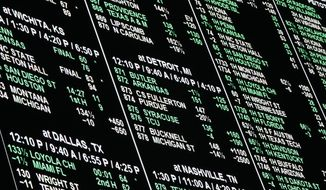 In this March 15, 2018, photo, a board displays odds for different bets on the NCAA college basketball tournament at the Westgate Superbook sports book, in Las Vegas. Proponents of legal sports gambling often point to Nevada as a model for effective monitoring. Sports betting has been legal in Las Vegas in some form since the 1930s. (AP Photo/John Locher) **FILE**