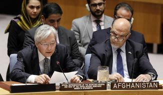 United Nations envoy for Afghanistan Tadamichi Yamamoto, left, addresses the United Nations Security Council, at U.N. headquarters, Monday, Sept. 17, 2018. He is accompanied by Afghanistan's U.N. Ambassador Mahmoud Saikal. (AP Photo/Richard Drew)