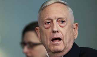 In this Tuesday, May 1, 2018, file photo, Secretary of Defense Jim Mattis answers a reporter's question during a meeting with Macedonian Defense Minister Radmila Sekerinska at the Pentagon. Mattis arrived in Macedonia on Monday, Sept. 17, condemning Russian efforts to use its money and influence to build opposition to an upcoming vote that could pave the way for the country to join NATO, a move Moscow opposes. (AP Photo/Manuel Balce Ceneta, File)