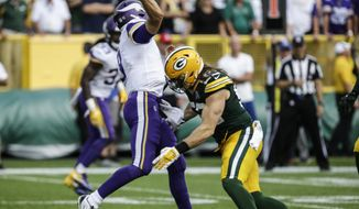 Green Bay Packers' Clay Matthews is called for a roughing the passer penalty during the second half of an NFL football game against the Minnesota Vikings Sunday, Sept. 16, 2018, in Green Bay, Wis. The game ended in a 29-29 tie. (AP Photo/Mike Roemer)