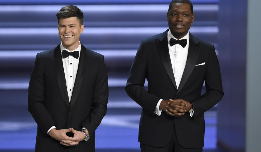 Hosts Colin Jost, left, and Michael Che speak at the 70th Primetime Emmy Awards on Monday, Sept. 17, 2018, at the Microsoft Theater in Los Angeles. (Photo by Chris Pizzello/Invision/AP)