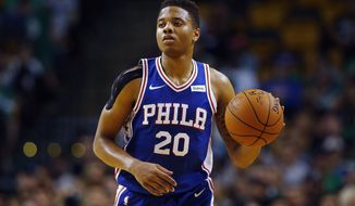 In this Oct. 9, 2017, photo, Philadelphia 76ers guard Markelle Fultz controls the ball during the first quarter of a preseason NBA basketball game against the Boston Celtics in Boston. Philadelphia 76ers coach Brett Brown is expecting more out of guards Ben Simmons and Markelle Fultz this season. The guards failed to hit a 3-pointer last season. Brown says the duo will have to be better from long range this season. (AP Photo/Winslow Townson) **FILE**