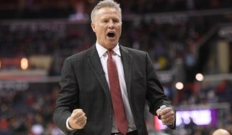FILE - In this Sunday, Feb. 25, 2018 file photo, Philadelphia 76ers head coach Brett Brown reacts towards the bench during the second half of an NBA basketball game against the Washington Wizards in Washington. Philadelphia 76ers coach Brett Brown said the organization will hire a general manger to replace Bryan Colangelo before the start of the season. (AP Photo/Nick Wass, File)