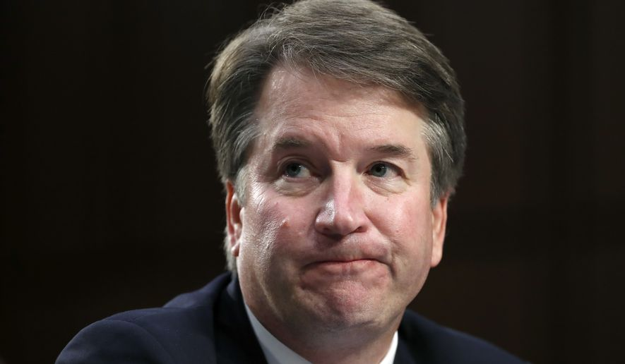 President Donald Trump's Supreme Court nominee, Brett Kavanaugh reacts as testifies after questioning by Sen. Cory Booker, D-N.J., before the Senate Judiciary Committee on Capitol Hill in Washington, Thursday, Sept. 6, 2018, for the third day of his confirmation hearing to replace retired Justice Anthony Kennedy. (AP Photo/Alex Brandon)