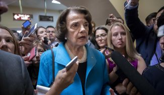 Sen. Dianne Feinstein, D-Calif., the ranking member on the Senate Judiciary Committee, responds to reporters' questions on Supreme Court nominee Brett Kavanaugh amid scrutiny of a woman's claim he sexually assaulted her at a party when they were in high school, on Capitol Hill in Washington, Tuesday, Sept. 18, 2018. (AP Photo/J. Scott Applewhite) **FILE**