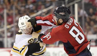 Washington Capitals' Liam O'Brien (87) fight with Boston Bruins forward Mark McNeill (62) during the second period of an NHL preseason hockey game Tuesday, Sept. 18, 2018, in Washington. (AP Photo/Nick Wass) ** FILE **