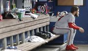 Washington Nationals' Bryce Harper sits in the dugout during the third inning of a baseball game against the Miami Marlins, Monday, Sept. 17, 2018, in Miami. (AP Photo/Wilfredo Lee)