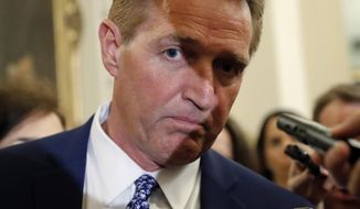 Sen. Jeff Flake, R-Ariz., a member of the Judiciary Committee, stops to speak to members of the media as he heads to Senate Chamber floor on Capitol Hill in Washington, Tuesday, Sept. 18, 2018. (AP Photo/Pablo Martinez Monsivais) **FILE**