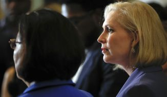 Sen. Kirsten Gillibrand, D-N.Y., right, and Sen. Mazie Hirono, D-Hawaii, left, speak to members of the media on Capitol Hill in Washington, Tuesday, Sept. 18, 2018. (AP Photo/Pablo Martinez Monsivais)