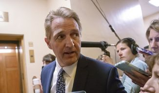 Sen. Jeff Flake, R-Ariz., a member of the Judiciary Committee, responds to reporters' questions on Supreme Court nominee Brett Kavanaugh amid scrutiny of a woman's claim he sexually assaulted her at a party when they were in high school, on Capitol Hill in Washington, Tuesday, Sept. 18, 2018. (AP Photo/J. Scott Applewhite) ** FILE **