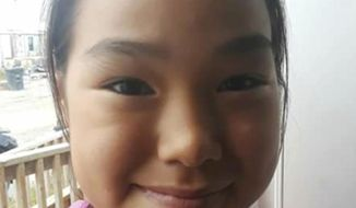 This undated photo provided by Scotty Barr shows Ashley Johnson-Barr. An Alaska man found with the cellphone of the missing girl was charged Monday, Sept. 17, 2018, in connection with her death after GPS coordinates of where the phone had traveled led authorities to the girl's body. (Scotty Barr via AP)