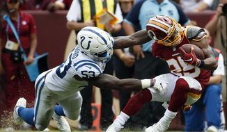 Indianapolis Colts linebacker Darius Leonard, left, tackles Washington Redskins running back Chris Thompson in the second half of an NFL football game, Sunday, Sept. 16, 2018, in Landover, Md. (AP Photo/Alex Brandon)