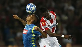 Napoli midfielder Allan, left, jumps for a header with Red Star's Richmond Boakye, during the Champions League group C soccer match between Red Star and Napoli, in Belgrade, Serbia, Tuesday, Sept. 18, 2018. (AP Photo/Darko Vojinovic)