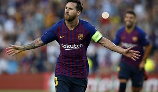 Barcelona forward Lionel Messi celebrates after scoring the opening goal of his team during the group B Champions League soccer match between FC Barcelona and PSV Eindhoven at the Camp Nou stadium in Barcelona, Spain, Tuesday, Sept. 18, 2018. (AP Photo/Manu Fernandez)