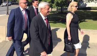 Former state Sen. Jeremy Hutchinson, left, arrives at the federal courthouse in Little Rock, Ark., Tuesday, Sept. 18, 2018, for his first court appearance on federal corruption charges. Hutchinson, who is also the governor's nephew, pleaded not guilty to charges that he spent thousands on dollars in campaign funds on personal items. Walking in with Hutchinson are, from second left, his father, former U.S. Sen. Tim Hutchinson, his attorney Tim Dudley and Randi Fredholm Hutchinson, Tim Hutchinson's wife and Jeremy's stepmom. (AP Photo/Andrew DeMillo)