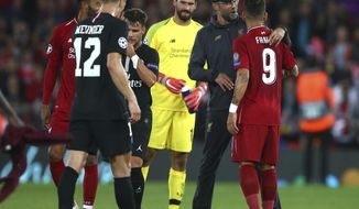 Liverpool's coach Juergen Klopp hugs Liverpool's Roberto Firmino at he end of the match after he scored his sides third goal during the Champions League Group C soccer match between Liverpool and Paris-Saint-Germain at Anfield stadium in Liverpool, England, Tuesday, Sept. 18, 2018. Liverpool won the match 3-2. (AP Photo/Dave Thompson)