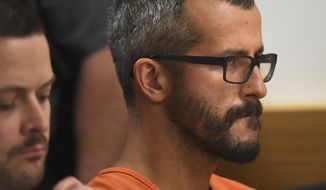 """File - In this Aug. 21, 2018 file photo, Christopher Watts is in court for his arraignment hearing at the Weld County Courthouse in Greeley, Colo. Colorado prosecutors want a judge to block release of the autopsy reports of a woman and two young girls found dead at an oil work site, arguing that the cause of their deaths will be """"critical evidence"""" during the trial of the man accused of killing his family. In a request filed in Weld County Court on Monday, Sept. 17, 2018, District Attorney Michael Rourke said releasing information from the autopsies could influence witnesses and affect future jurors. Watts, 33, was arrested and charged in August with murdering his 34-year-old pregnant wife, Shanann, and their two daughters, four-year-old Bella and three-year-old Celeste. (RJ Sangosti/The Denver Post via AP, Pool, File)"""