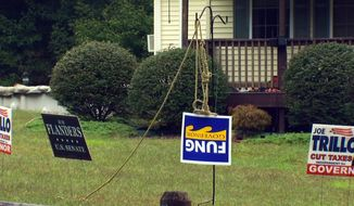 A sign for Rhode Island Republican gubernatorial candidate Allan Fung hangs from a noose, Tuesday, Sept. 18, 2018, in front of a home in Glocester, R.I. Homeowner Ray Izzo said he's upset Fung didn't participate in the typical series of debates before the primary and believes he's within his rights to keep the display, according to WJAR-TV . He said it's not about race, it's about taxes. (WJAR-TV via AP)