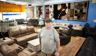 ADVANCE FOR SATURDAY, SEPT. 22 AND THEREAFTER George Kearn, a graduate of the homeless veterans program, runs Full Circle Furnishings in Beloit which sells used furniture to support the homeless vets program. Seen here on Thursday, Sept. 6, 2018, at the store in Beloit, Wis.  (Angela Major/The Janesville Gazette via AP)