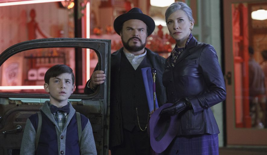 "This image released by Universal Pictures shows Owen Vaccaro, from left, Jack Black and Cate Blanchett in a scene from ""The House With A Clock in Its Walls.""  (Quantrell D. Colbert/Universal Pictures via AP)"